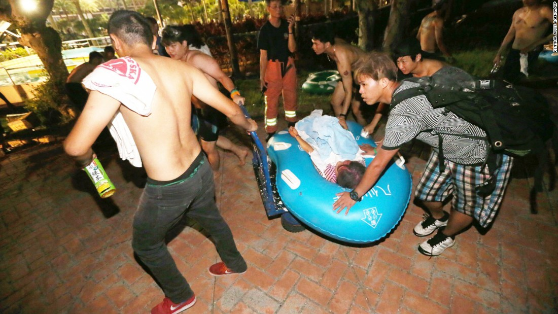 Concert spectators tend to injured victims after an accidental explosion.