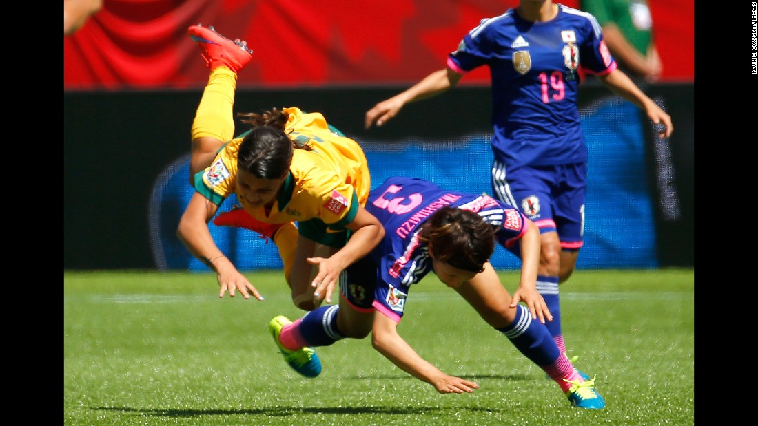 Samantha Kerr of Australia flies in the air as she is fouled by Iwashimizu.