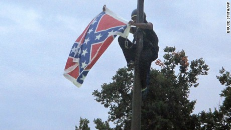 Activists take down Confederate flag in South Carolina
