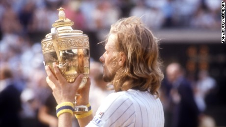 JUL 1976: A PICTURE SHOWING BJORN BORG OF SWEDEN AS HE LIFTS THE TROPHY AFTER WINNING THE WIMBLEDON TENNIS TOURNAMENT