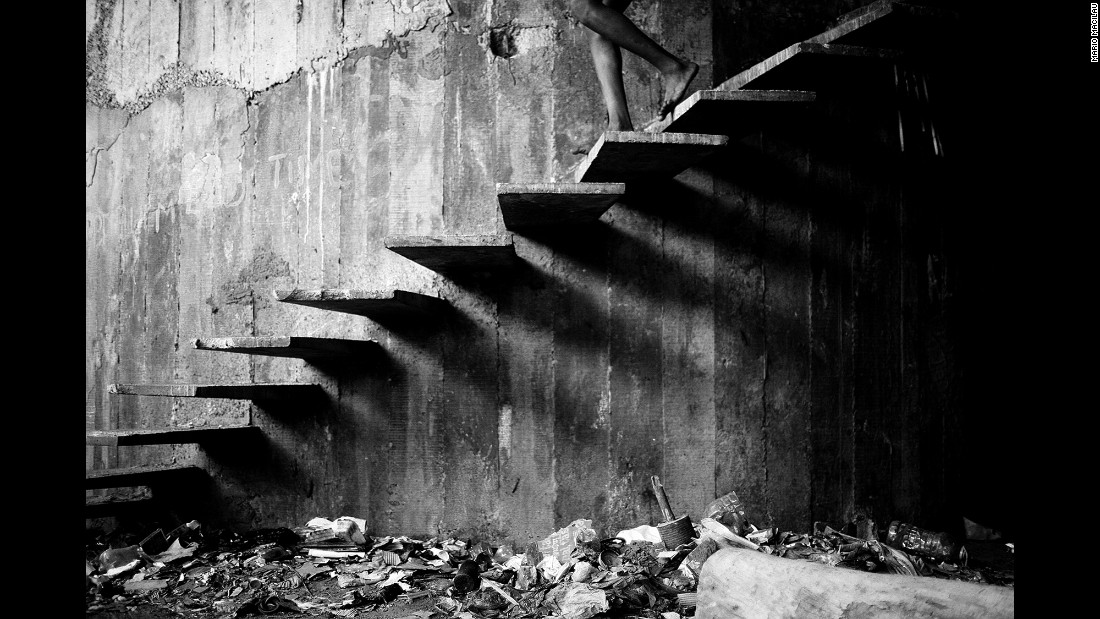 Stairs create shadows on the walls of an abandoned old building in downtown Maputo. There are no toilets, and water must be drawn from a nearby source.