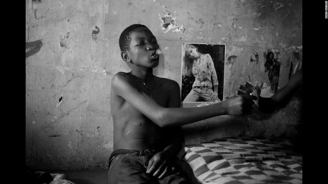 A 15-year-old boy smokes with his friends in Maputo.