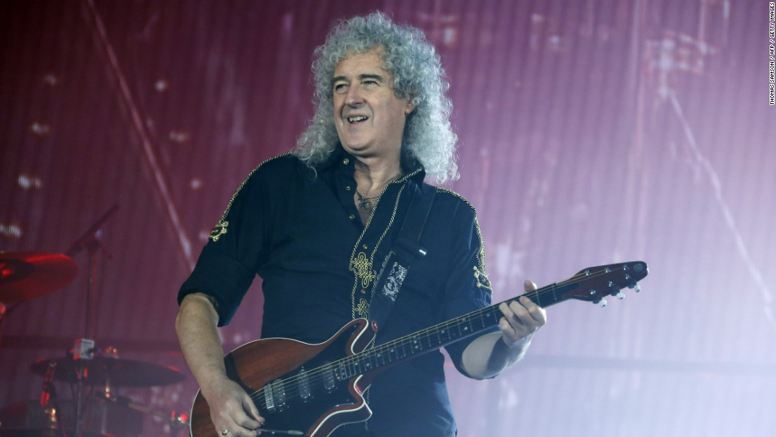 Queen's performance was hailed as a highlight of Live Aid. Lead guitarist Brian May -- who now holds a doctorate in astrophysics -- is shown here in 2015. The band's current lead singer, Adam Lambert, stands in for the late Freddie Mercury who died in 1991.