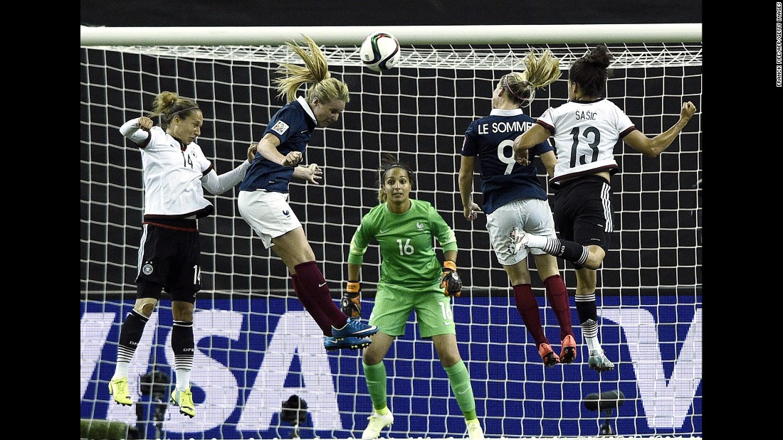 "French midfielder Amandine Henry, second from left, jumps for a header while playing Germany in the <a href=""http://www.cnn.com/2015/06/06/sport/gallery/women-worlds-cup-2015/index.html"" target=""_blank"">Women's World Cup</a> on Friday, June 26. After the match in Montreal ended 1-1 in extra time, Germany won a penalty shootout to advance to the semifinals."