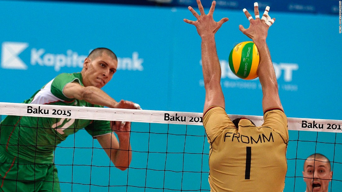 Bulgaria's Jani Jelaskov spikes the ball against Germany's Christian Fromm during the European Games' gold-medal volleyball match Sunday, June 28, in Baku, Azerbaijan. Germany won the match 3-1.