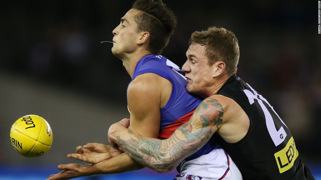 Tim Membrey of the St. Kilda Saints tackles Luke Dahlhaus of the Western Bulldogs during an Australian Football League match in Melbourne on Saturday, June 27.