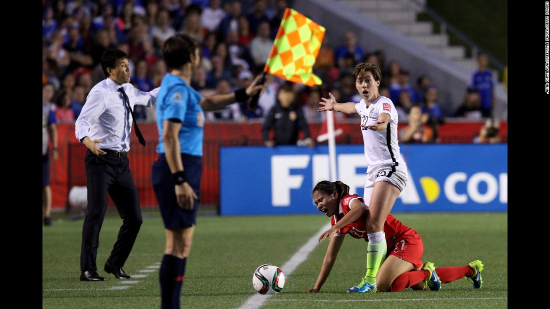 "U.S. defender Meghan Klingenberg stands over China's Wang Lisi during a Women's World Cup quarterfinal match on Friday, June 26. The <a href=""http://www.cnn.com/2015/06/12/football/gallery/usa-highlights-womens-world-cup/index.html"" target=""_blank"">United States</a> won the match 1-0 in Ottawa."
