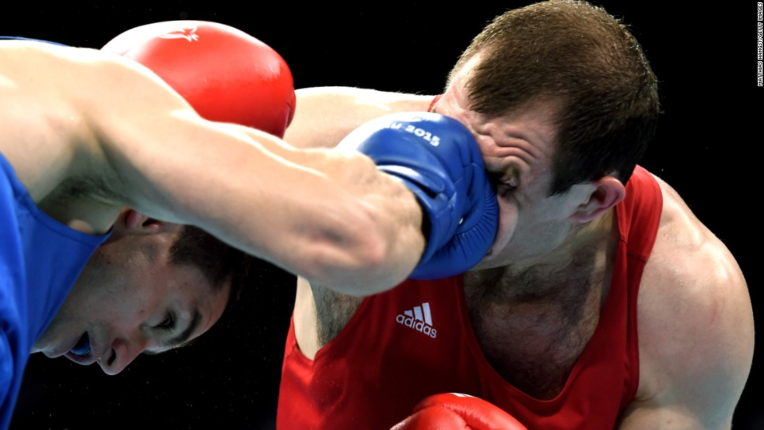 Azerbaijan's Xaybula Musalov, left, punches Belarus' Vitali Bandarenka during a middleweight bout at the European Games on Wednesday, June 24. Musalov won on points but eventually lost in the final to Ireland's Michael O'Reilly.