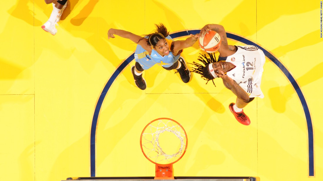 Indiana's Lynetta Kizer, right, grabs a rebound during a WNBA game against Chicago on Friday, June 26.
