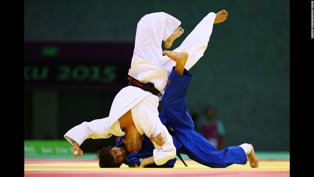 Azerbaijani judoka Orkhan Safarov, in white, competes against Russia's Beslan Mudranov at the European Games on Thursday, June 25. Mudranov won the match to clinch gold in the 60-kilogram (132-pound) weight class.