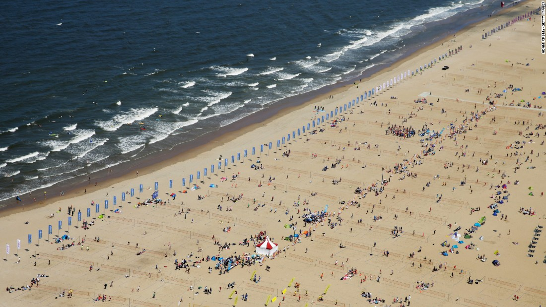 "Scheveningen Beach, in The Hague, Netherlands, <a href=""http://netherlands2015.fivb.org/en/news/beach-volleyball-world-record-set-in-the?id=53782"" target=""_blank"">sets a Guinness World Record</a> for most people playing beach volleyball at once. At least 2,355 people played Saturday, June 27, as they took part in the Beach Volleyball World Championships."
