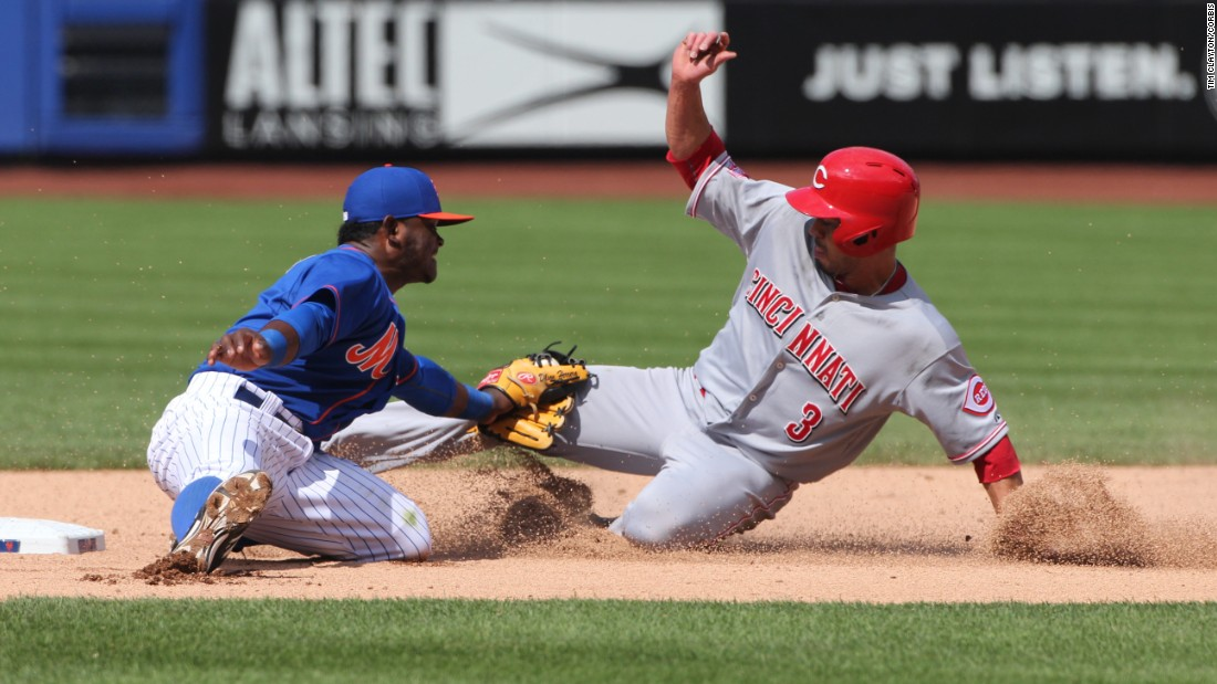 While trying to steal second base, Cincinnati's Ivan DeJesus Jr. is tagged out by Dilson Herrera of the New York Mets on Sunday, June 28.