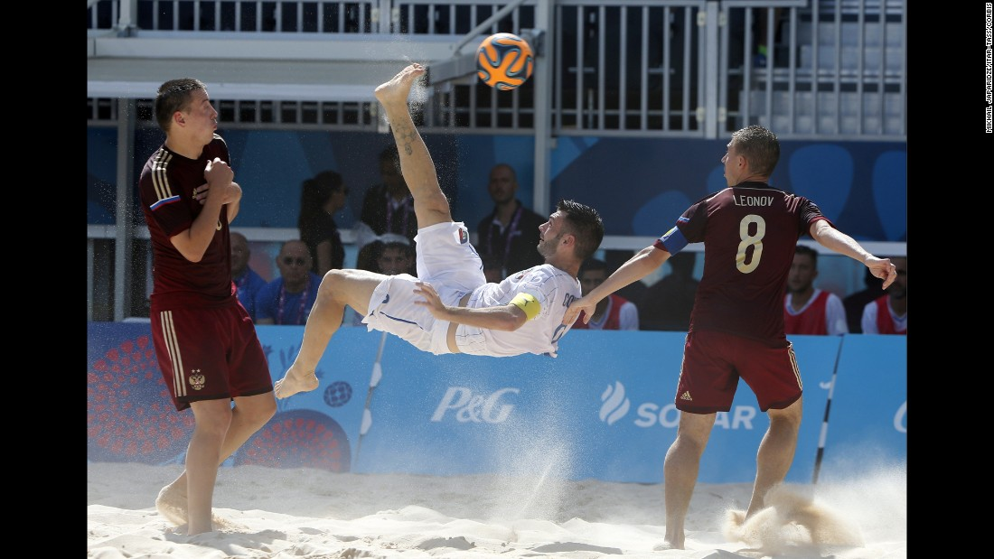 Italy's Francesco Corosiniti performs an overhead kick against Russia during the European Games' beach soccer final on Sunday, June 28. Russia won the match 3-2.