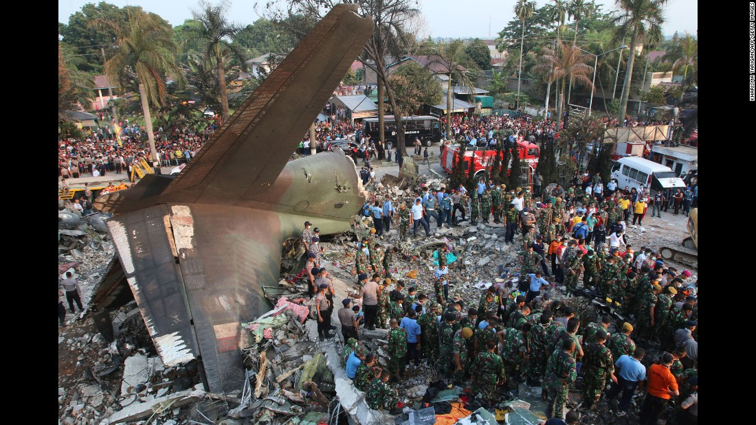 Search and rescue teams work at the site where an Indonesian air force cargo plane crashed in Medan, Indonesia, on Tuesday, June 30.