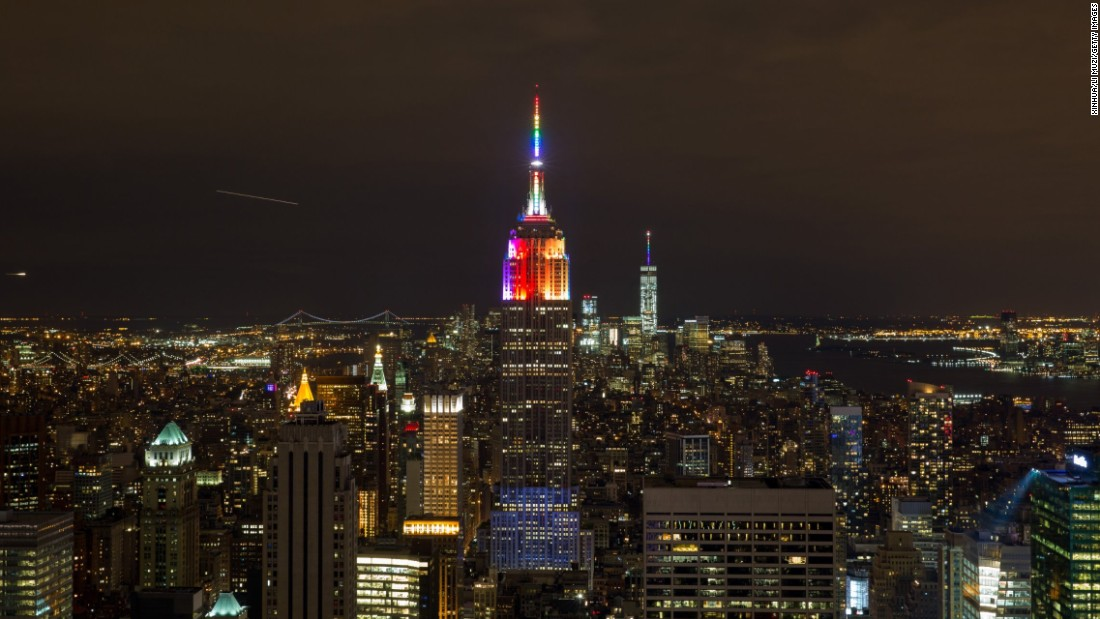 "The Empire State Building was among the many iconic buildings that were lit in rainbow colors in celebration. ""I've been a little bit flabbergasted,"" Baker says."