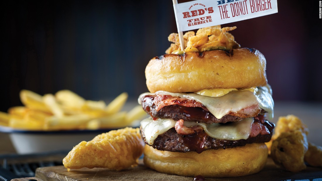 Red's True Barbecue's donut burger, found in the UK, allows you to eat lunch and dinner at the same time. Two beef patties, strips of bacon and cheese are sandwiched between two glazed donuts.