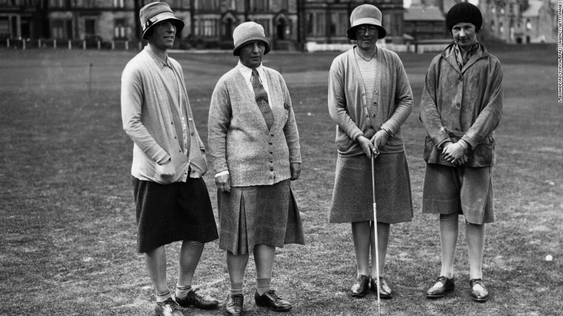 "Four first-round competitors in a Ladies' Scottish Foursomes tournament on the Royal and Ancient Course in June 1928.<br /><br />Women golfers would sometimes wear what was called a ""Miss Higgins Hoop.""<br /><br />""It was really just a piece of elastic that was moved up to around their knees and designed to keep your skirt from blowing up in the wind -- women had to remain modest. Often what would happen is that they would weight their skirts with wire along the bottom edge rather than having the Miss Higgins Hoop,"" Fleming says. <br /><br />""During the 1920s and 1930s women's fashion in general changed -- there was less corsetry -- so golf fashion kind of reflects wider fashions."""