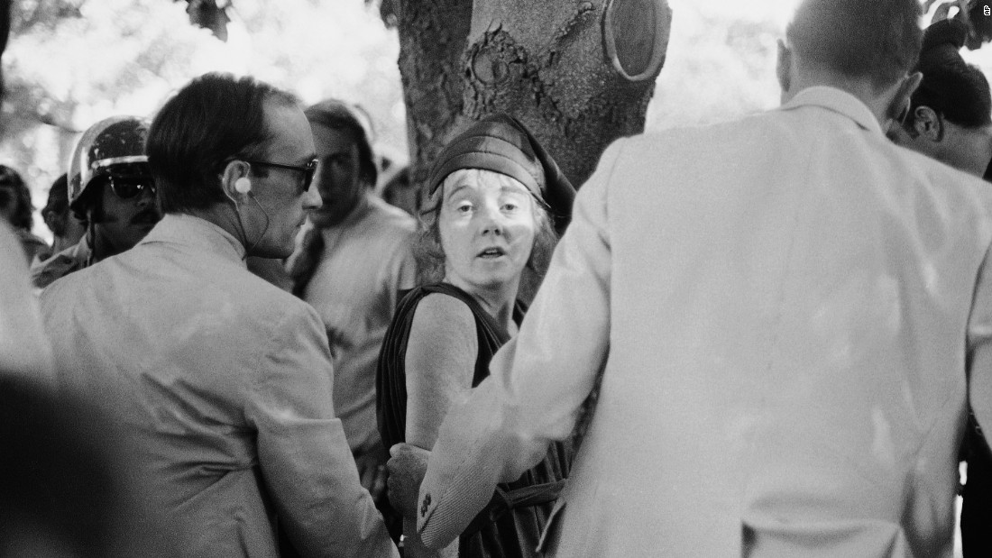 "U.S. Secret Service agents lead away Lynette ""Squeaky"" Fromme, a member of Charles Manson's ""family,"" after she allegedly pointed a .45-caliber pistol at Presisdent Gerald Ford on the grounds of the California State Capitol in 1975. According to Jeff Guinn, author of ""Manson,"" her first words after the being wrestled to the ground were, ""Can you believe the gun didn't go off?"" Fromme was paroled in 2009."