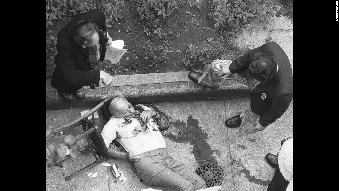 "The bloodied body of mafia chieftain Carmine ""Lilo"" Galante, his final cigar still in his mouth, lies on the floor of a backyard garden in a Brooklyn restaurant July 12, 1979. Galante was gunned down along with an associate and the restaurant's owner. The killers allowed Galante's two bodyguards to leave unharmed. The murder is believed to have been part of a power struggle among New York's organized crime families."