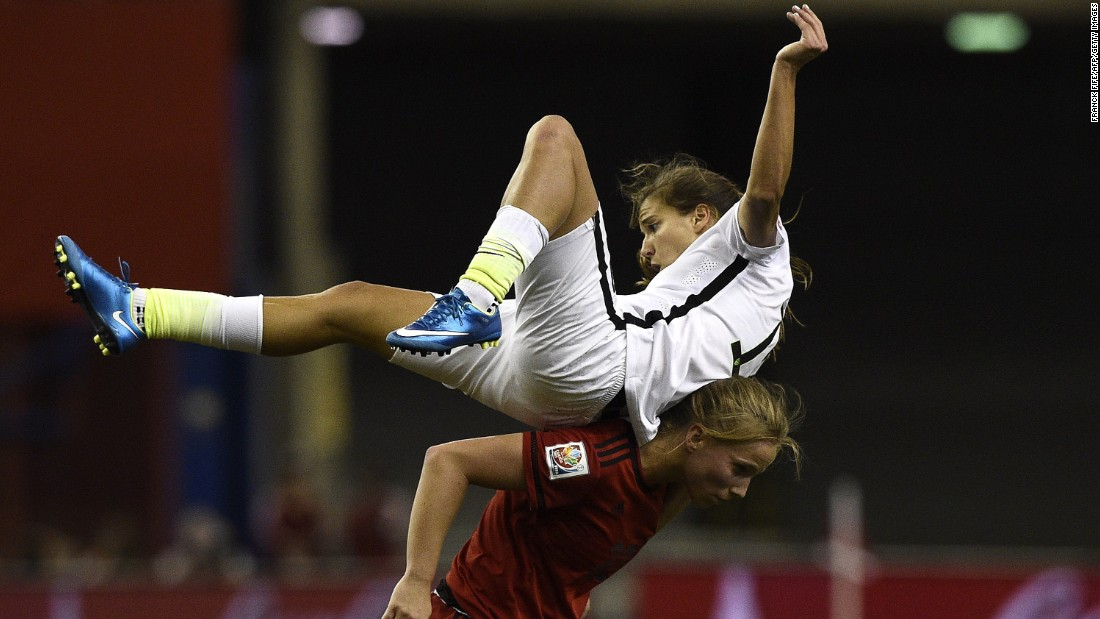 U.S. midfielder Tobin Heath gets knocked over by Germany's Tabea Kemme.