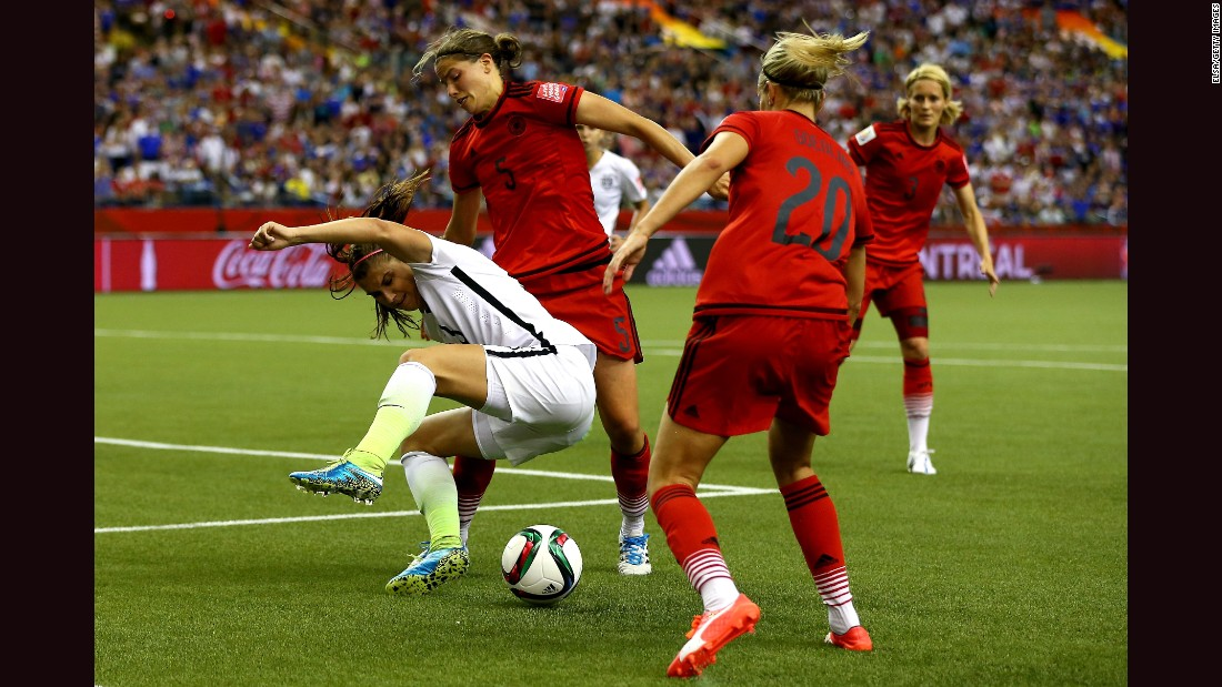 Alex Morgan of the United States is defended by Germany's Annike Krahn, left, and Lena Goessling.