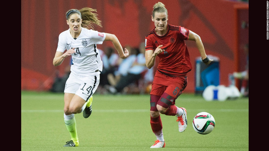American Morgan Brian, left, and German Simone Laudehr chase down the ball.