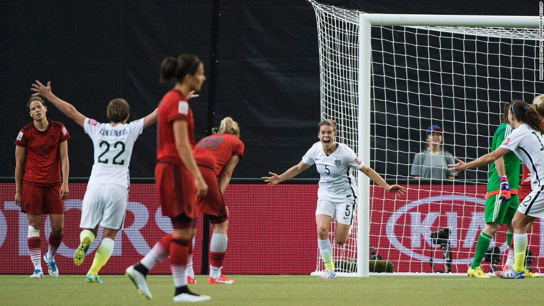 American Kelley O'Hara, center in white, celebrates after scoring a goal against Germany on Tuesday, June 30. The goal, late in the second half, clinched a 2-0 semifinal victory for the Americans. They will now get a rematch against Japan, the team that defeated them in the 2011 World Cup final.