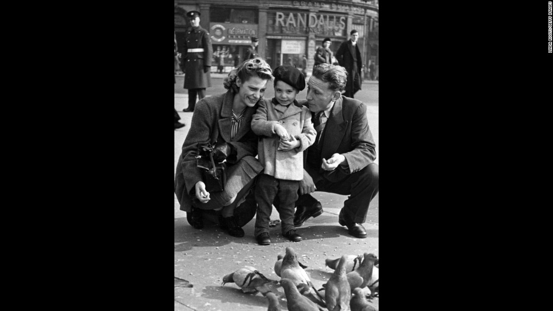 Charles Robert Watts, 2, feeds birds with his mother, Lillian, and his father, Charles, in London's Piccadilly Circus in 1943. Charlie was known as Charlie Boy because his father was called Charlie. Watts was asked to play drums when the Rolling Stones were forming. He denied the invitation until 1963.