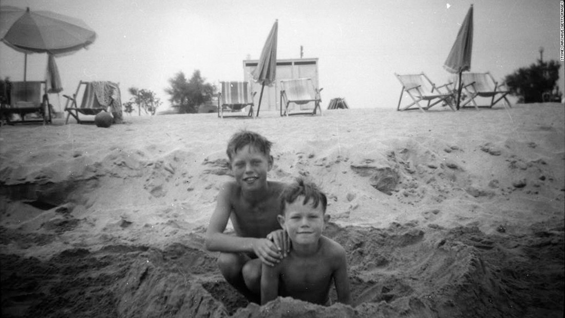 An 8-year-old Jagger, left, plays at the beach with his younger brother Chris in 1951. Chris is also a musician and has worked as a clothing designer and journalist.