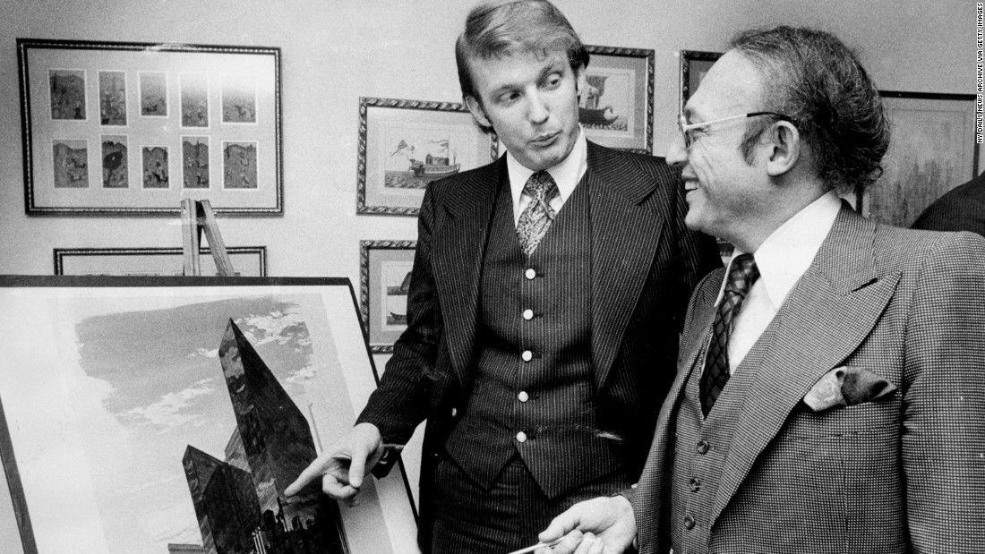 Trump stands with Alfred Eisenpreis, New York's economic development administrator, in 1976 while they look at a sketch of a new 1,400-room renovation project of the Commodore Hotel. After graduating college in 1968, Trump worked with his father on developments in Queens and Brooklyn before purchasing or building multiple properties in New York and Atlantic City, New Jersey. Those properties included Trump Tower in New York and Trump Plaza and multiple casinos in Atlantic City.