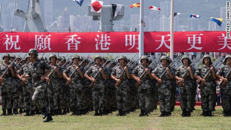China shows off its guns in Hong Kong