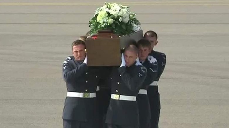 British victims of Tunisia massacre return home