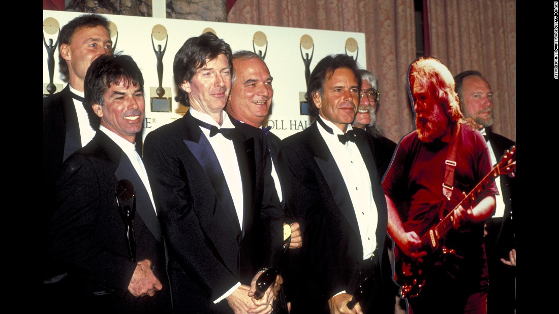 Members of the Dead pose with a cutout of Garcia after being inducted into the Rock and Roll Hall of Fame in 1994.