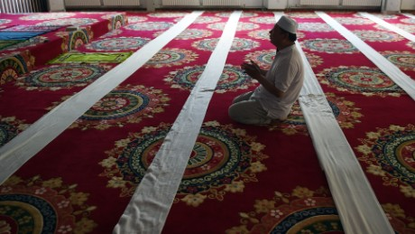 A Chinese Muslim man prays on the first day of Ramadan, the Muslim holy month, at a mosque in Beijing on June 18, 2015.