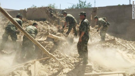 Chinese soldiers carry out rescue work after Friday's earthquake.