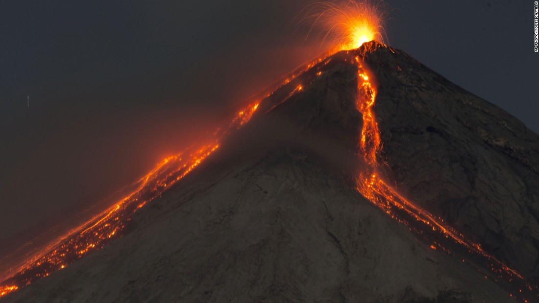 "Taken with a long exposure, the image shows Volcan de Fuego -- or Volcano of Fire -- spewing hot molten lava from its crater on early Wednesday. A government spokesperson said the volcano was billowing ""fiery clouds"" throughout the day."