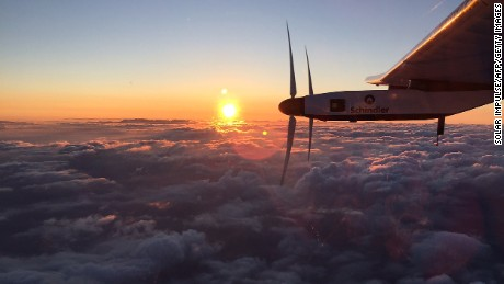 "This handout photo taken early on June 29, 2015 and provided by the Solar Impulse project shows sunrise a little while after the Swiss-made solar-powered plane Solar Impulse 2 took off from the international airport in Nagoya, Japan, headed for Hawaii. The revolutionary Solar Impulse 2 aircraft passed ""the point of no return"" on June 29 after it left Japan bound for Hawaii, the most ambitious leg of its quest to circumnavigate the globe powered only by the sun. Swiss pilot Andre Borschberg, 62, left the city of Nagoya around 3:00 am (1800 GMT), five days after weather problems forced the organisers to cancel an earlier attempt."