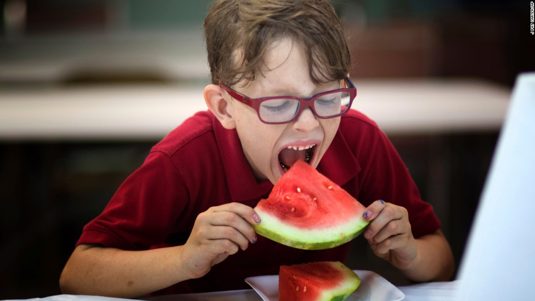 Liam Meredith competes in the watermelon-eating contest at the Old Fashioned Fourth event at Flamingo Gardens in Davie, Florida, on Saturday.