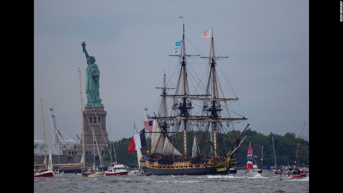 The Hermione passes near the Statue of Liberty as it leads the Lafayette Parade of Ships up the Hudson River in New York.