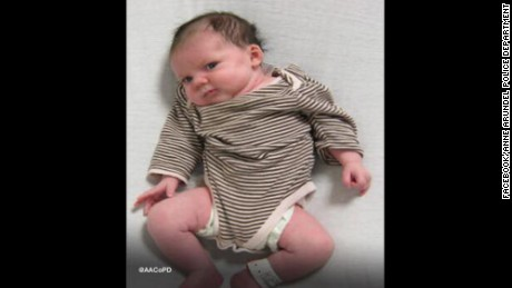 Police share photo of baby found on roadway.