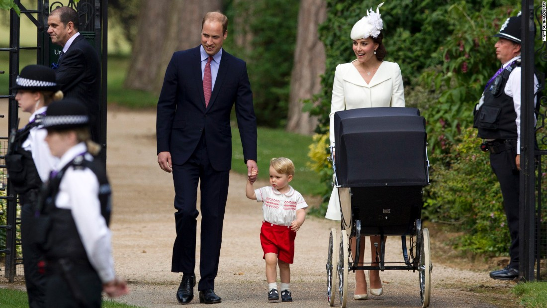 The royal family arrives for the christening.