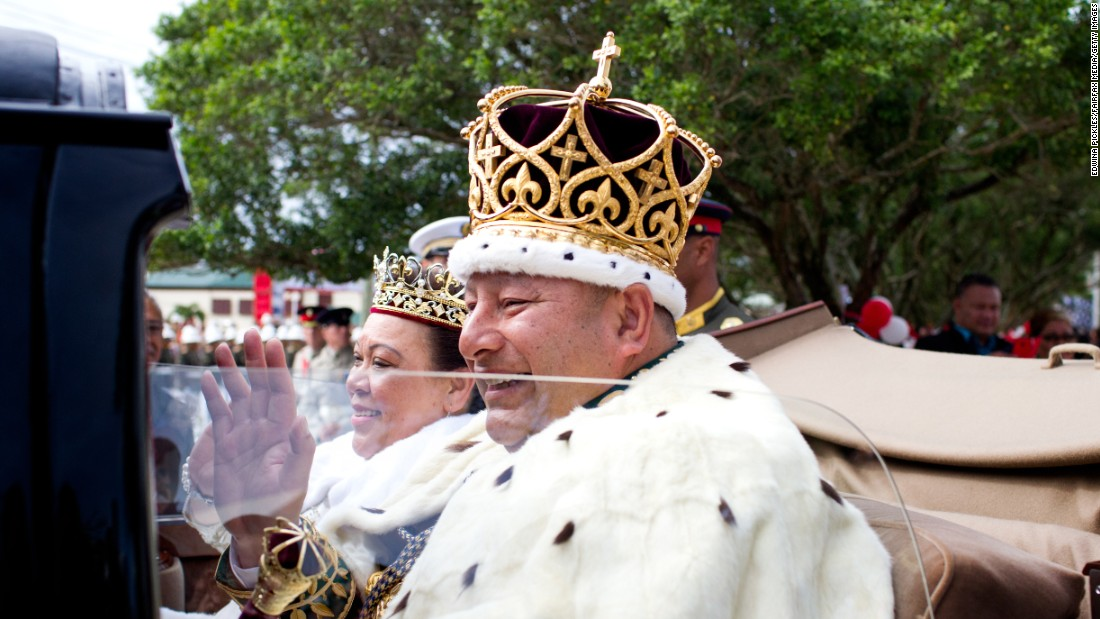 Newly crowned King Tupou VI and his wife, Queen Nanasipau'u, of Tonga proceed through the streets to the Royal Palace as part of the official coronation ceremony on July 4.