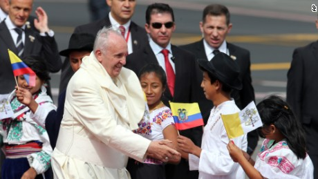 Pope Francis greets several children upon his arrival to the Mariscal Sucre International airport in Quito Sunday.