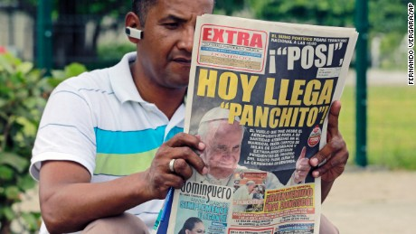 A man reads a newspaper outside the Samanes Park where Pope Francis will give a mass on Sunday.