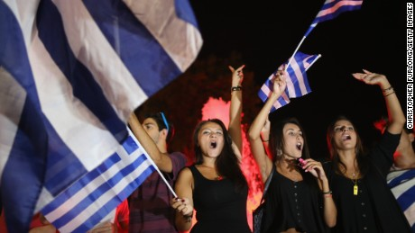 People celebrate in front of the Greek parliament in Athens on July 6 after voters rejected a debt bailout by creditors.