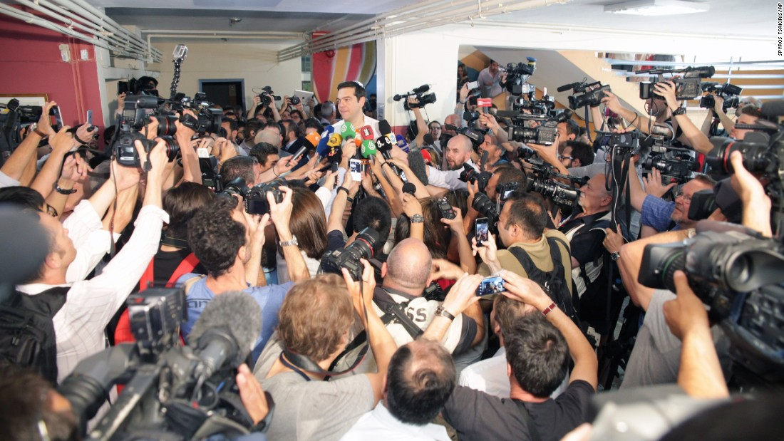 Greece's Prime Minister Alexis Tsipras speaks to the media after voting at a polling station on Sunday, July 5.