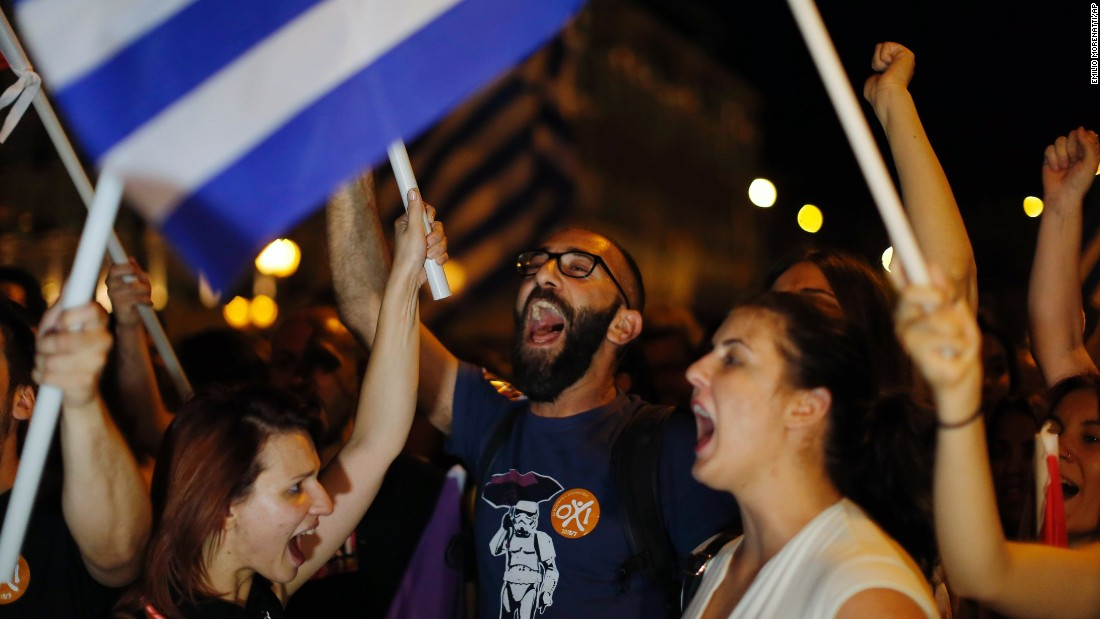 Supporters of the No vote celebrate after the results of the referendum in Athens on Sunday, July 5, 2015. Voters in Greece resoundingly rejected creditors' demands for more austerity in return for rescue loans, backing Prime Minister Alexis Tsipras, who insisted the vote would give him a stronger hand to reach a better deal.