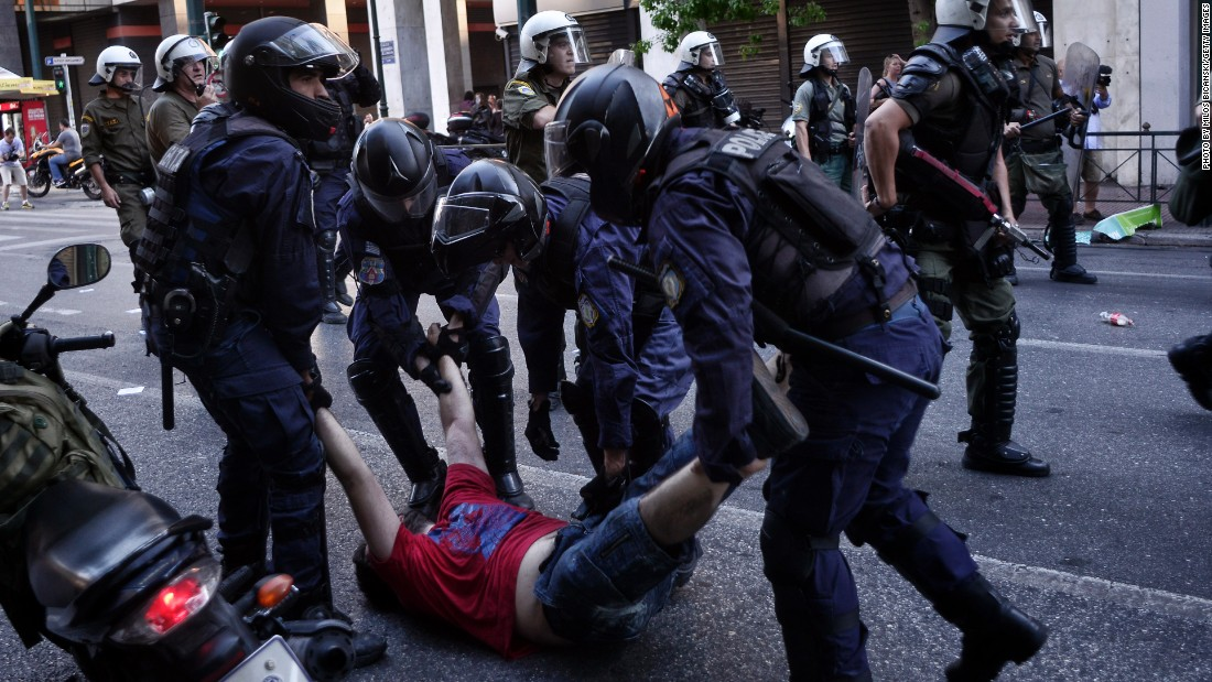 A demonstrator is arrested during an anti-austerity rally.