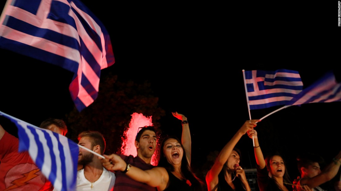 People wave Greek flags and shout slogans as they celebrate after the results of the referendum in Synatagma Square in central Athens on Sunday, July 5.