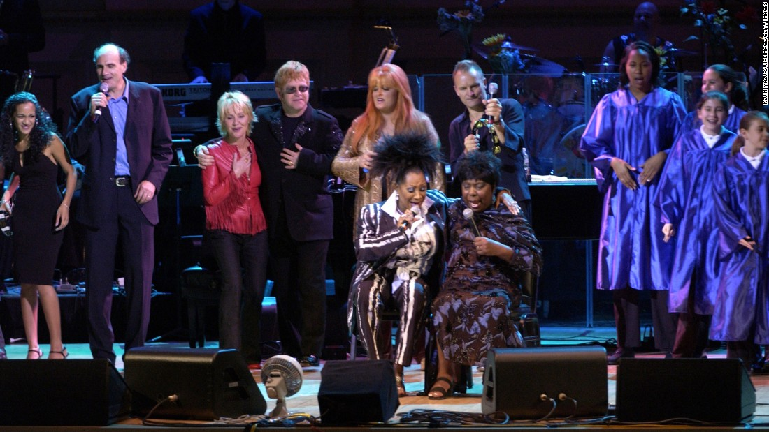 Patti LaBelle, bottom left, sings with Simone during the 2002 Rainforest Foundation Concert in New York. In the top row, from left, are Anoushka Shankar, James Taylor, Lulu, Sir Elton John, Wynonna Judd and Sting.